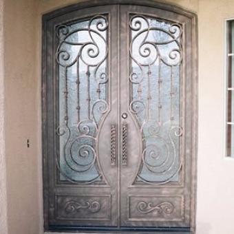 Puertas de comunidad puertas de hierro y forja metalicas for Precio de puertas de forja