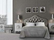 Dormitorio de matrimonio con cabezal en pìel