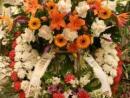 Corona de dos cabeceros de gladiolos,rosas,gerberas lilium y sterlizias